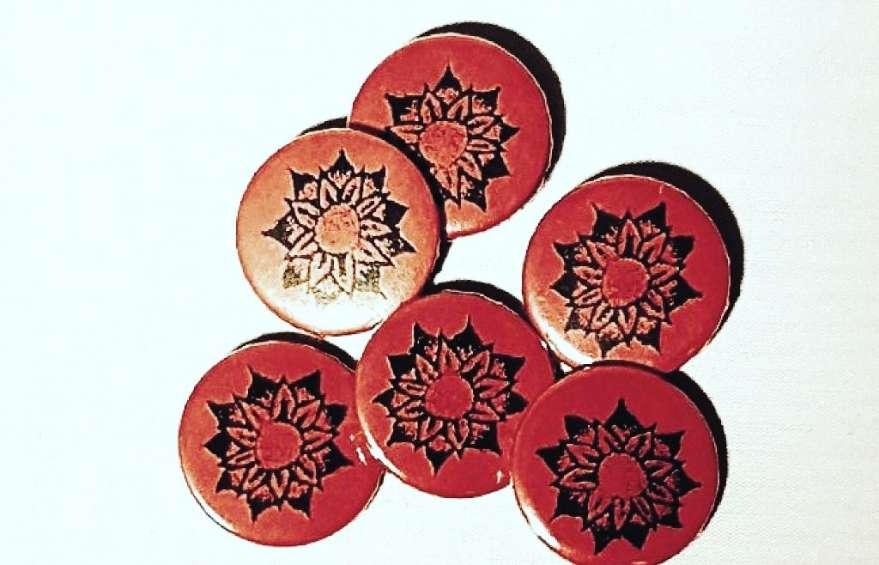 Add custom printed badges to your merch range
